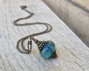 Boro lampwork pendent necklace in brass one of a kind, waves
