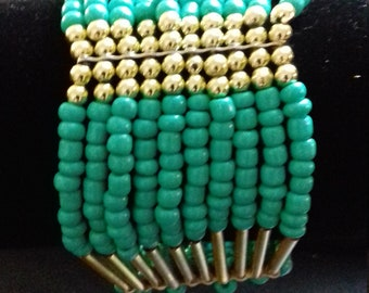 Turquoise and gold Cuff Bracelet.