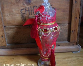 Old red and gold liquor decanter