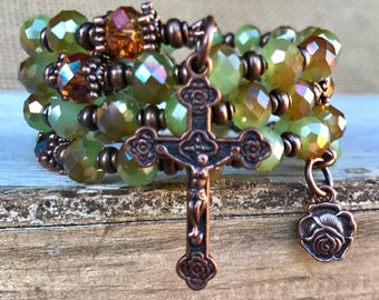 Handmade 5 decade rosary wrap bracelet with faceted czech glass beads and tibetan copper. Five decade memory wire cuff.