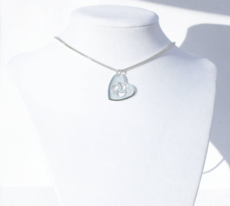Bdsm symbol cutaway heart shape pendantsterling silver snake description sterling silver triskele bdsm symbol pendant biocorpaavc Gallery