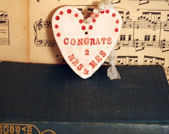 Congrats Mrs and Mrs Heart Handmade Pottery Heart with red & white glazes. Sent to you in a gossamer bag ready to give as a gift.