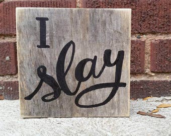 Hand painted I Slay sign on gray brown reclaimed barn wood.