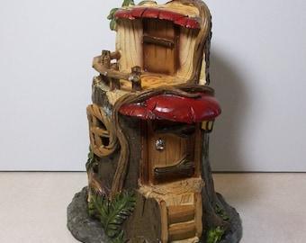 On sale was 14.95.  Miniature garden Tree house: Fairy, gnome, terrarium house