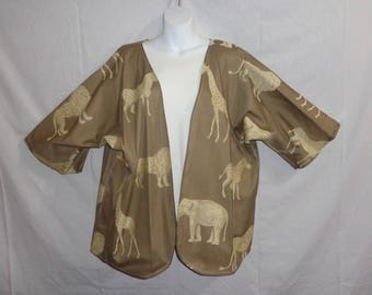 These beautiful Reversible Kimono Jackets will add a splash of excitement and elegance to many outfits.  Safari animal design w/ Khaki  .