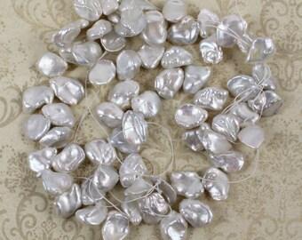 """16"""" Strand of White Keshi or Cornflake Pearls"""