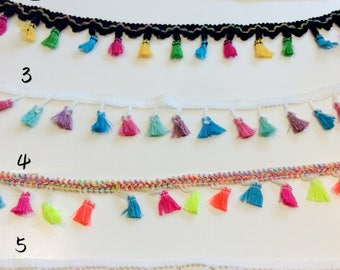 Bright and colourful fabric trimmings in 5 designs. Sold Per Metre