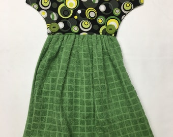 Dress Dish Towel.  Green circles on Dress top with a green towel.