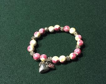 Beaded bracelet with locket