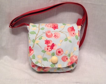 AP9- Pocket Perfect: small purse pink bloosoms pattern on a pale blue background