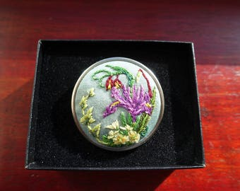 Brooch, pin. Iris, fritillary, and primrose pin. Hand embroidered in a silver brooch, pin.
