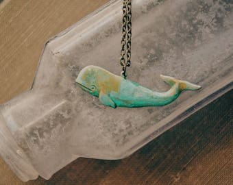 ancient seas. a nautical patina whale necklace.