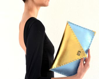 Gold and metallic light blue leather clutch