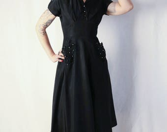 1940s Vicky Vaughn Junior black evening dress, pockets and diamonté buttons