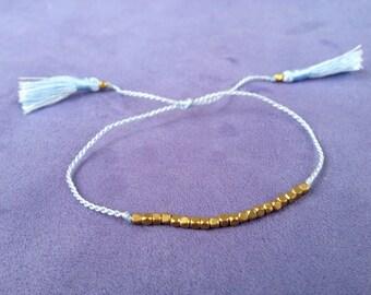 "Bracelets ""Echo Beach"", bronze beads, twisted nylon thread, sliding node and Pompom"