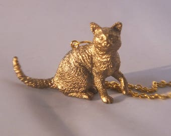 cattykins gold necklace statement