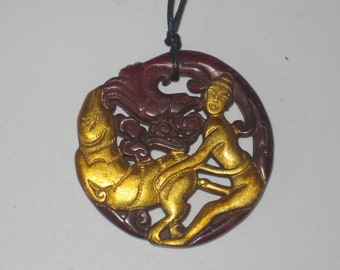All natural hand carved two sided Jade man & beast pendant, with adjustable necklace.