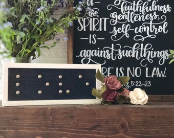 Selah Signs LOVE Braille sign