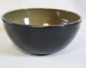 Breakfast bowl. Handmade, thrown, and turned stoneware bowl. Dark green decorating slip with green glaze.