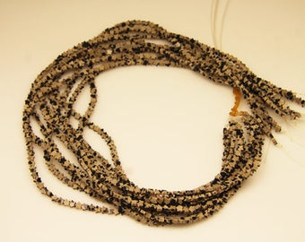 1strand - natural dalmatian jasper star sized 4.5mm