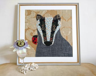 Badger picture - a piece of textile art made using applique with recycled fabrics