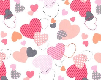 Love Dee Da by Michael Miller, sold by HALF YARD.  Hearts.