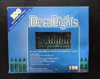 DecoLights Indoor/Outdoor bulbs remain lit if one burns out.safety fuse plug steady burn or flashing 32 feet green bulbs and cord 100 lights
