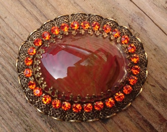 Vintage orange rhinestone brooch