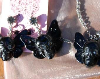 Tarina Tarantino skull with wings necklace earrings set.
