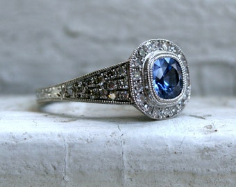 Halo Pave Diamond and Sapphire Tapered Engagement Ring.