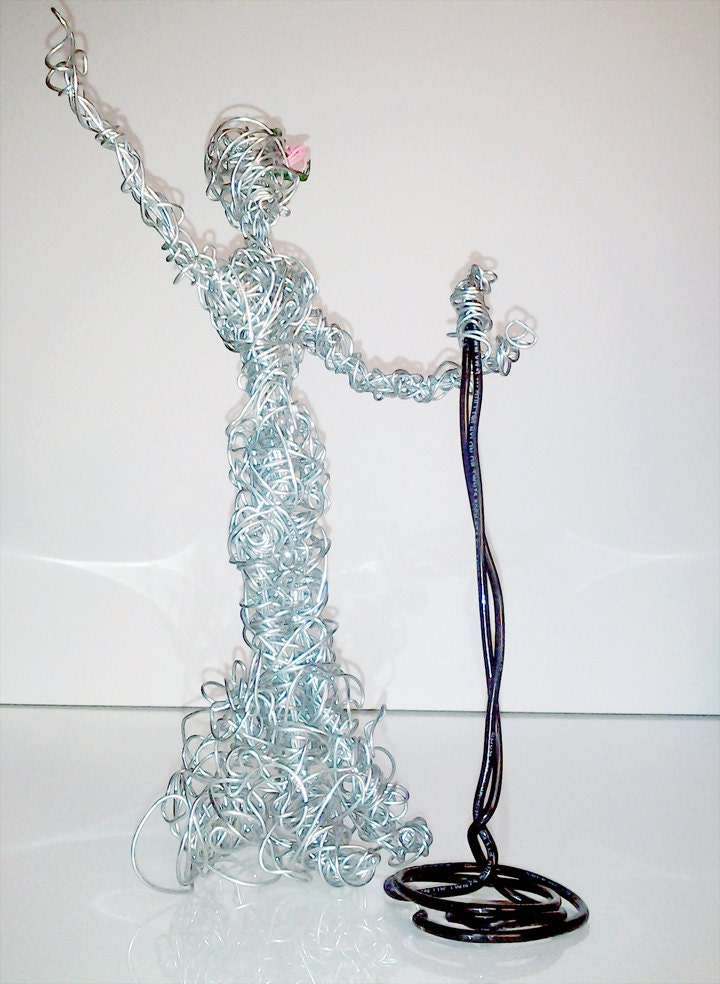 Wire person metal sculpture singing lady opera microphone wire