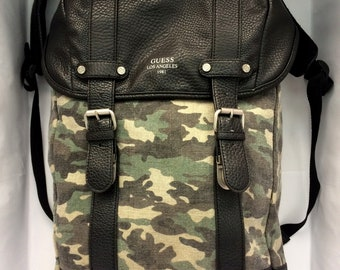 Vintage Bag Backpack The original Guess Los Angeles 1981 military made of real leather and fabric also a compartment for laptop