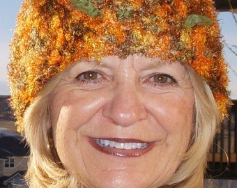 Cute crochet hat with just enough fuzz, fuzzy orange and green yarn make for a cozy hat, women's winter hat that's chic and quality handmade