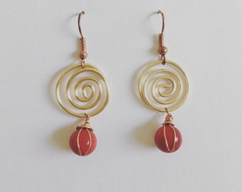 Gold swirl drop earrings
