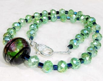 Green Faceted Glass and Large Glass Focal Bead Necklace With Silver Plated Heart Clasp