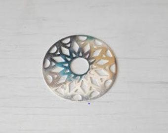 Silver round filigree part.