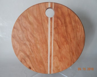 Round hardwood cutting board with cherry