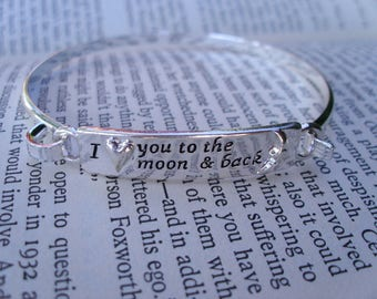 Silver bangle engraved 'I love to the moon and back' bracelet with a heart and the moon