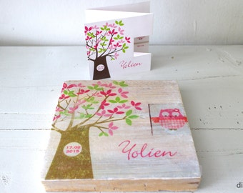 Birth announcement card on wood