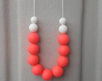 Baby silicone teething necklace- hot pink and white