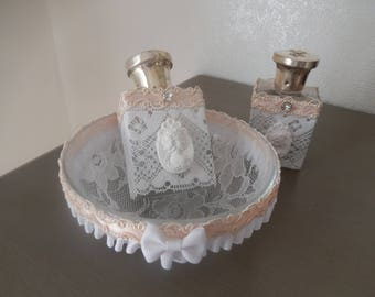 shabby bathroom vanity, ring and two flasks trimmed with lace and cameo silver cap