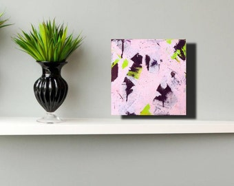 Small square abstract painting in pink and black