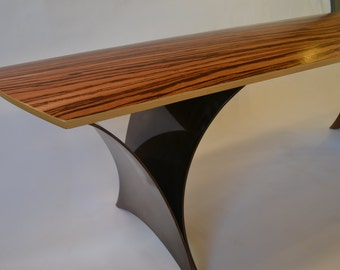 the 'winged bench' with tiger wood top & aluminum legs anodized dark bronze