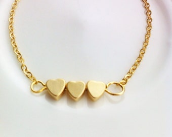 Three hearts . Gold