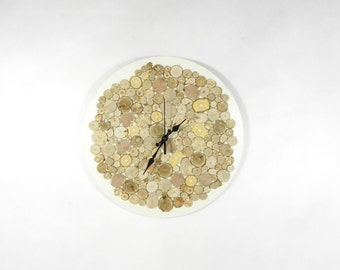 White wall clock is handmade with wood slices