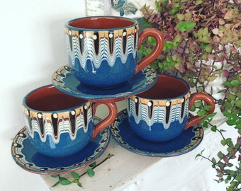 Retro earthenware pottery cups & saucers, feathered/marbled glazed, redwear.
