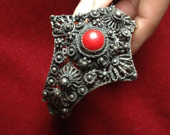 Metal filigree, wire work bracelet with red cabochon