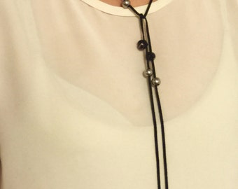 Chic suede, wrap, bolo tie necklace, with beads or pearl.