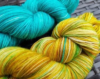 Shawl Pair: Sekhmet; 2 x 100g complementary yarn skeins, hand dyed sock weight merino/nylon yarn