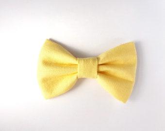 Light yellow bow tie. Spring, wedding, photo shoot.